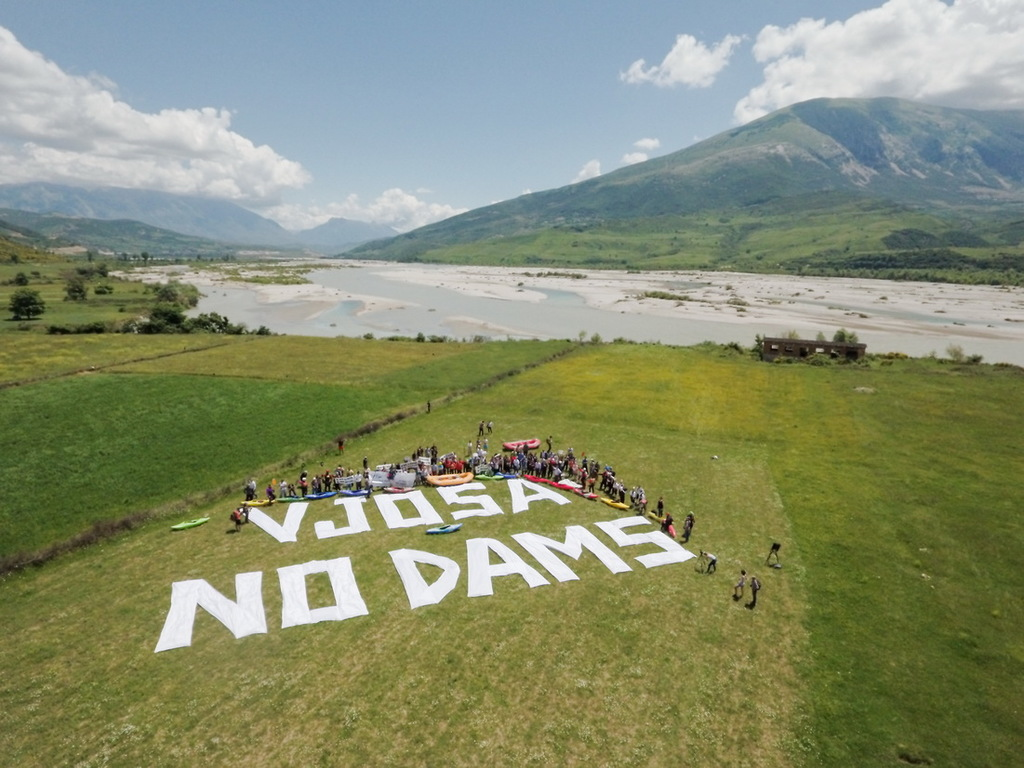 """Vjosa no dams"" have written the protesters at the banks of Vjosa river."