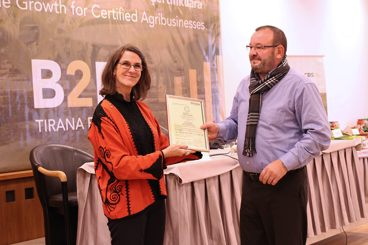 USAID Albania Representative, Dr. Catherine Johnson giving to Treg Tur Korça Company the GlobalG.A.P. Certification, a requirement for international trades with developed EU and international market. Photo: AgroWeb